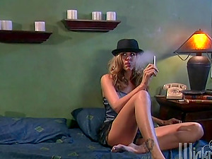 Julia Ann smokes a ciggy and then gets banged on a couch