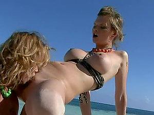 Lezzie Threesome On The Beach.