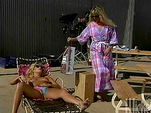 Nasty lesbos have an outdoor fuck-a-thon using a strapon