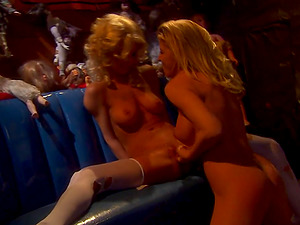 Two sexy platinum-blonde honies are touching each other