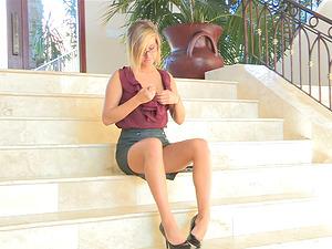 Attractive Blonde In Miniskirt Fingerblasting Her Snatch