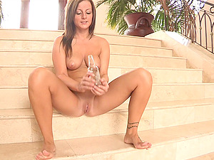 Sizzling Melissa drills her bum and a twat with an empty bottle