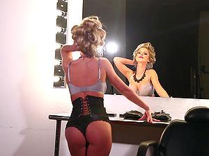 Kimber Cox wears a sexy corset in solo scene