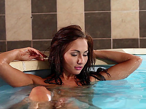 Michaela Isizzu shows her sexy assets in an indoor pool