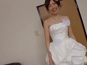 An Asian female in a wedding sundress gets fucked by two guys