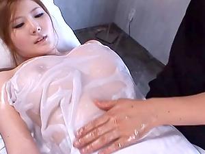 Oiled up Momoka Nishina gets toyed with two fake penises
