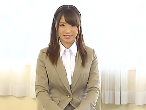Japanese stunner is masturbated in her work clothes