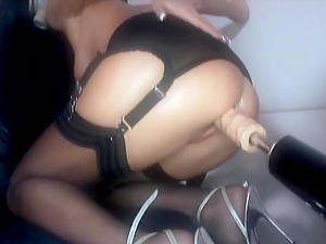 Horny honey wears a gas mask while being fucked by a machine