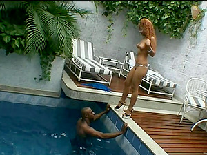 Curvy ginger-haired lovin? a xxx interracial fuck next to her swimming pool