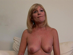 Mature blonde Jessica Sexxxton shows her tits and smooth-shaven cunt