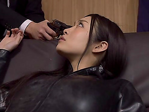 A Japanese female in a leather bodysuit gets group-fucked in an office