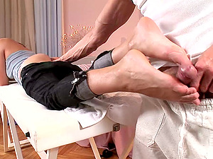 Abbie Kat gives a footjob and gets her snatch fucked from behind