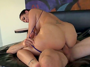 A hot dark haired stunner with big booty rails a dick passionately