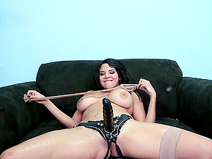 Endearing lezzy in stockings getting drilled using strapon in the office