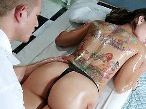 A sexy tattooed doll gets oiled up, caressed down and fucked by her masseuse