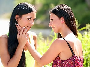 Nathaly Cherie and Bailey Ryder explore each other's pink slits outdoors
