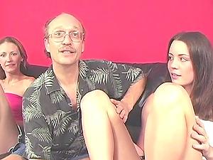 Hailey and her GF showcase their footjob abilities to an elderly man