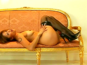 Hot Pornographic star in Leather Underpants and Fishnets Plays