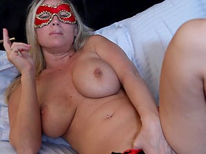 Devon Lee wears a mask while sucking and titty fucking a stud