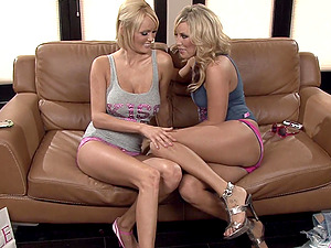 Hanna Hilton and Kiara Diane have a nice pastime on the couch
