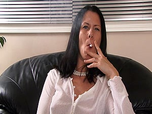 Sexy dark-haired cougar smokes invitingly and gives an interview
