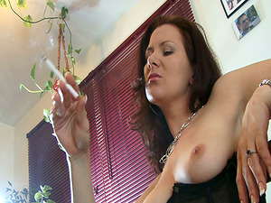 Hot cougar shows off her tits while smoking in solo clip
