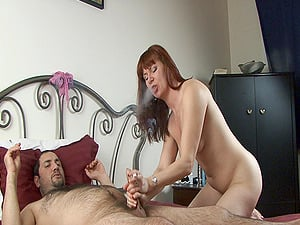 Ginger-haired mom smokes and gives a blow-job and a handjob to a boy