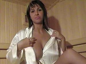 Kora Kryk oils and kneads her massive natural tits