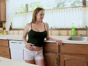 Gorgeous Teenager Playing With A Big Plastic Manstick On Her Kitchen Table