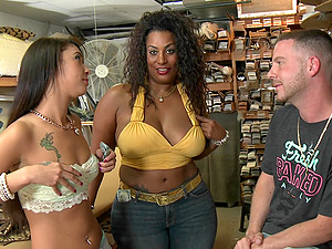 Horny ladies have a threesome with an employee in a dry cleaner
