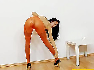 Ell Storm masturbates while being covered by nylon