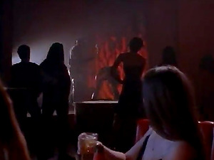 A chick in a mask dances naked at a club in a cool retro movie
