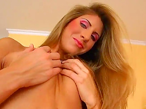 Alluring Mummy with lengthy hair squeezing her big tits before banging her cootchie with massive fucktoys