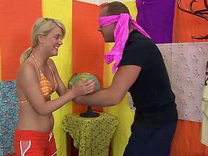 Flattering Blonde In Bathing suit Providing Massive Dick Handjob
