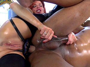 Robert Axel lets big-boobed red-haired Veronica Avluv fuck his caboose with a fucktoy