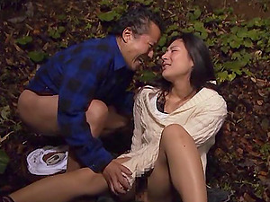 Sexy Asian doll with a hairy twat fucking a horny old man in a forest