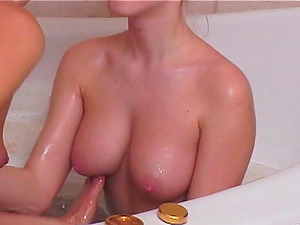 Lesbos with natural tits fuck using playthings in the bathroom