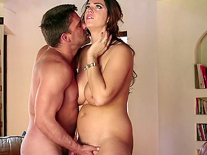 Chubby dark-haired with big faux tits loving a xxx cowgirl style fuck