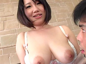 Japanese mom shows her big natural tits and gets her twat finger-tickled