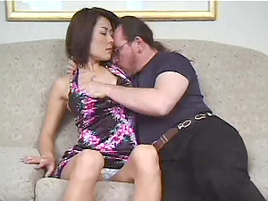 Japanese cougar gives head to her hubby and rails his dick