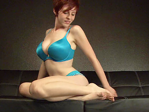 Hot red-haired stunner with brief hair demonstrating her sexy feet