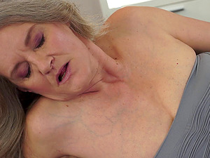 A girl/girl granny tempts a junior chick for some vagina tonguing joy