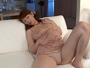 A Japanese mature stunner soaks thru her undies while fingerblasting