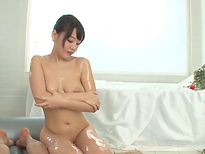 Zestful Japanese stunner with natural tits providing an oily rubdown before getting fucked gonzo
