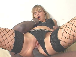 Her wide open asshole withstands a large black pecker