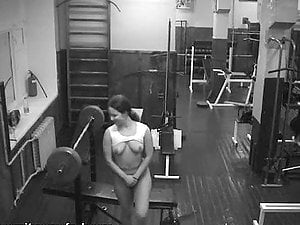 Security web cam in the weight room tapes the horny dame