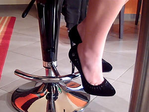Italian solo model showcasing her feet in a bar for a foot worship