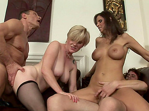 Two couples exchange and have fun during a wild bisexual four way