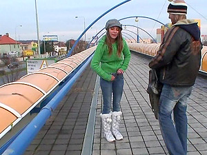 On a highway overpass he pulls down her jeans and fucks her