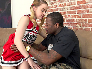 A black dude with a massive hard-on demolishes a milky cheerleader's labia